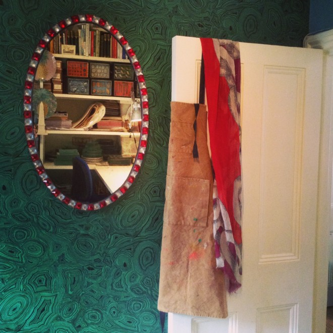 Obligatory apron hanging off door. Also the malachite wall and a gorgeous reproduction Irish Mirror by David Turner that I haven't found a place for in the shop yet. I wonder why?